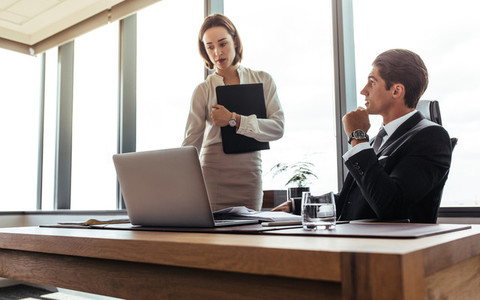 Two business professional working together in office
