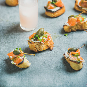 Crostini with smoked salmon and grapefruit cocktails square crop