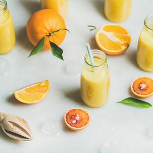 Healthy yellow smoothie with citrus fruit  square crop