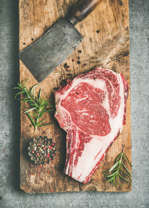 Raw prime beef meat dry aged steak rib eye and chopping knife