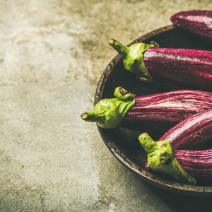 Fresh raw Fall harvest purple eggplants  copy space