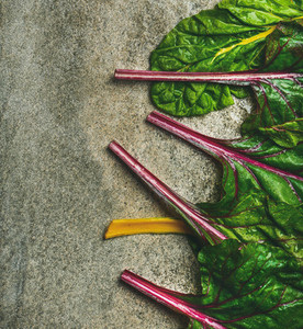 Flat lay of fresh leaves of swiss chard  vertical composition