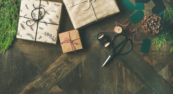 Flat lay of gift boxes rope fur branches scissors pine cones