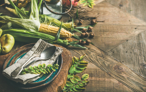 Fall table setting with seasonal vegetables for Thanksgiving day celebration