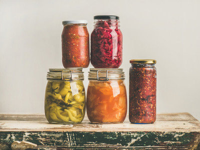 Autumn seasonal pickled or fermented colorful vegetables in glass jars