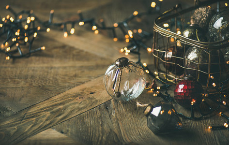 Christmas decoration balls in box and light garland  copy space