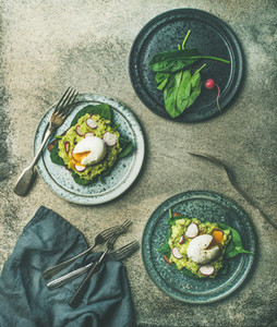 Healthy vegetarian wholegrain avocado toasts with poached egg