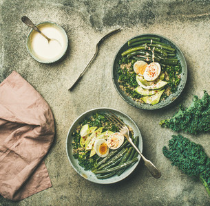 Healthy vegetarian breakfast bowls flat lay over grey background