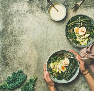 Quinoa  kale  beans  avocado  egg bowls  copy space
