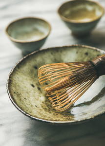 Japanese tools and bowls for brewing matcha tea  selective focus