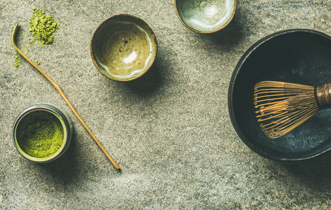 Japanese tools for brewing matcha tea  grey background  copy space