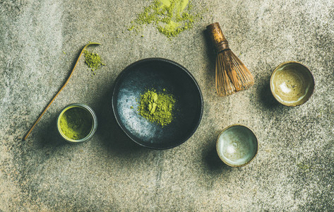Japanese tools for brewing matcha green tea  grey concrete background