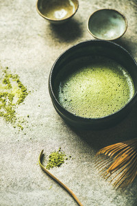 Flat lay of freshly brewed Japanese matcha green tea in bowl