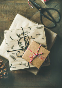 Flat lay of gift boxes rope scissors over rustic wooden table