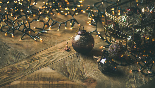 Christmas tree decoration balls in vintage box and light garland