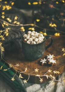Christmas winter hot chocolate with marshmallows in dark mug