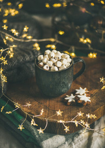 Christmas winter hot chocolate with marshmallows in dark mug