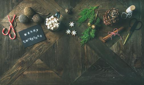 Flat lay of greeting card glittering toys hot chocolate cinnamon scissors