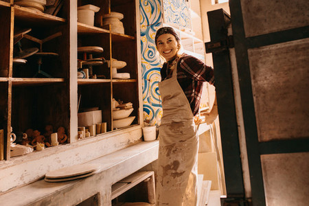 Female potter in pottery workshop