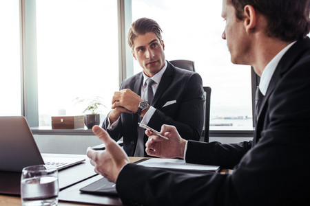 Corporate professionals having discussion in office