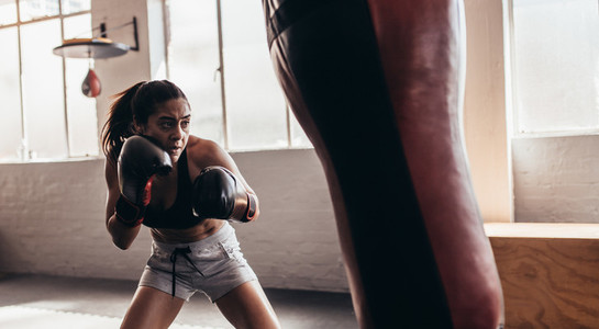Female boxer training inside a boxing ring