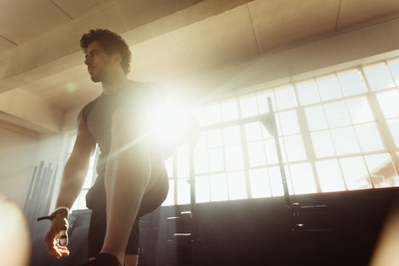 Focused male athlete at cross training gym