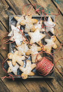 Christmas gingerbread star and angel shaped cookies with sugar powder