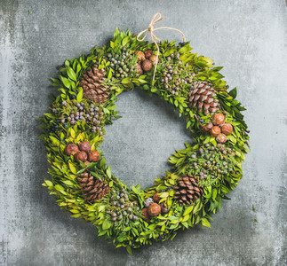 Christmas decorative wreath over concrete wall background