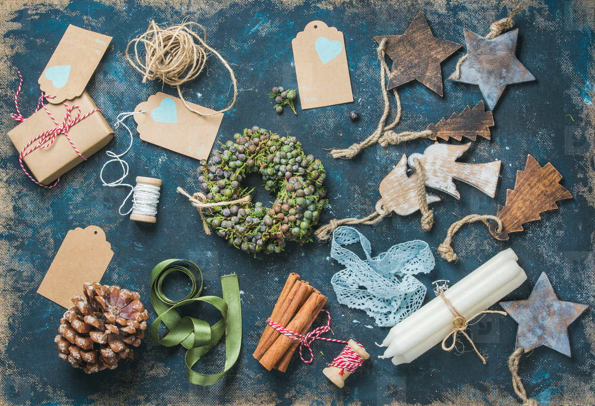 Christmas related objects on shabby table background