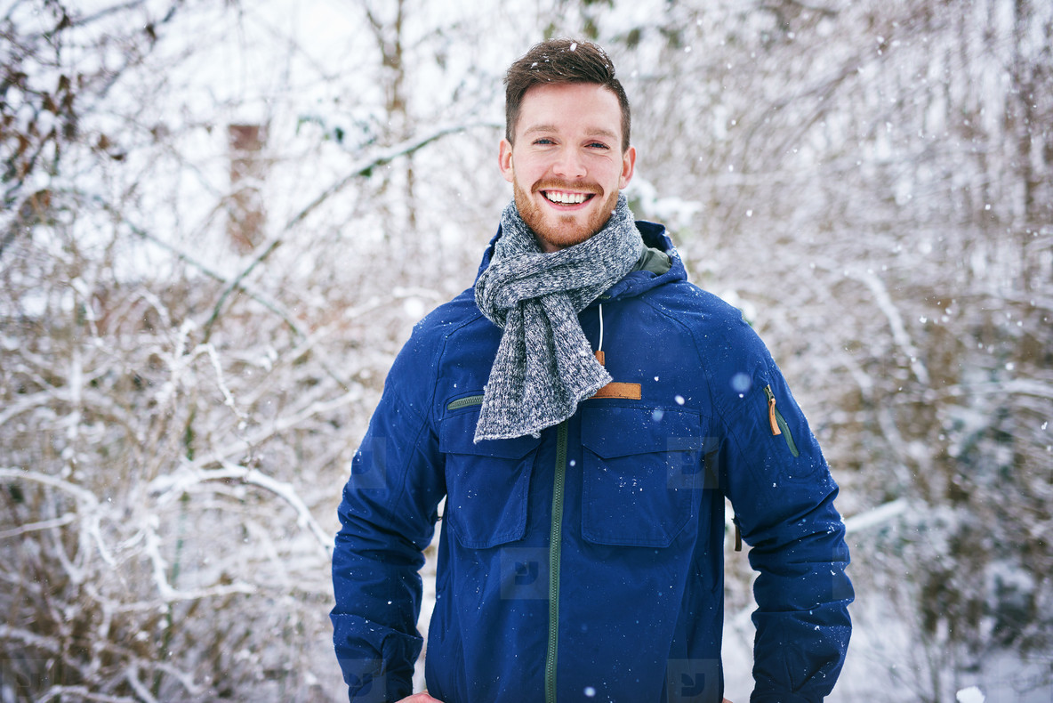 Handsome male in coat smiling at camera