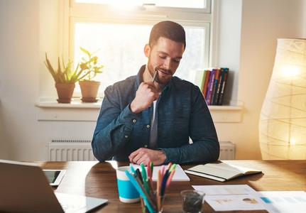 Satisfied entrepreneur at office