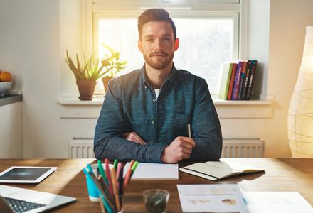 Confident authoritative young businessman