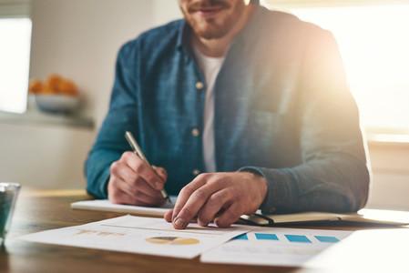Businessman analysing statistical charts