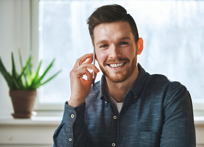 Smiling man talking on phone