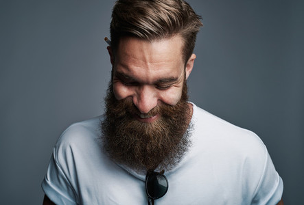 Giggling young man with large fuzzy beard