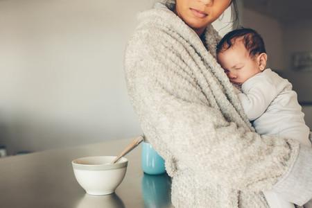 Newborn baby boy sleeping in his mother039 s hands