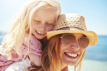 Young mother with her daughter at the beach