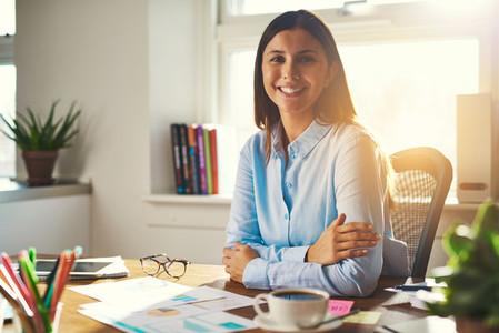 Female entrepreneur sitting at her desk
