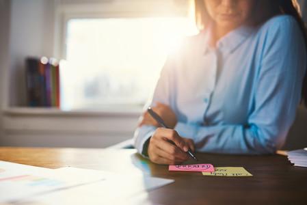 Closeup business woman writing notes