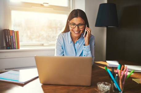 Smiling woman working at laptop