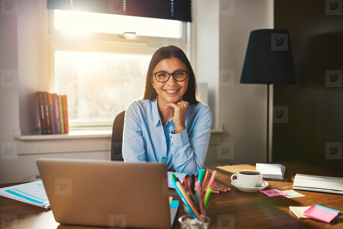 Female entrepreneur sitting at desk