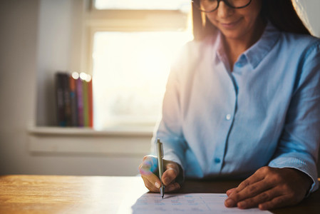 Selective focus of woman working at home office
