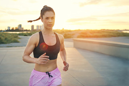 Beautiful and toned female jogger running