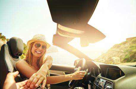 Happy driver touching hand of passenger