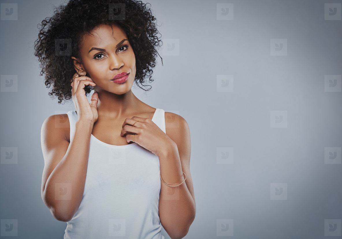 Serious Black woman with fingers by ears