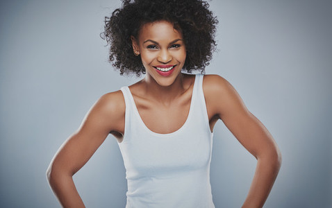 Beautiful happy woman over gray background