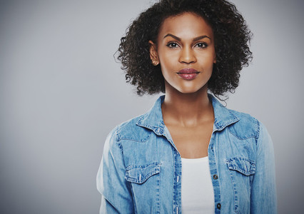 Interested black woman with blue jean shirt