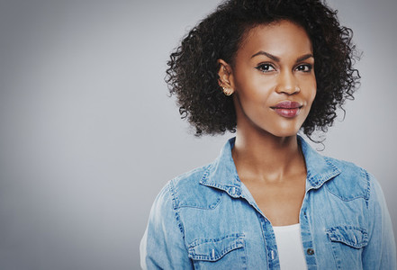 Beautiful black woman with blue jean shirt