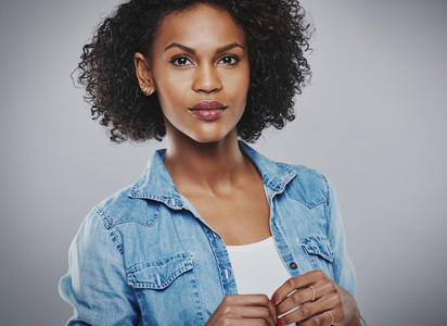 Serene woman with blue jean shirt and white top