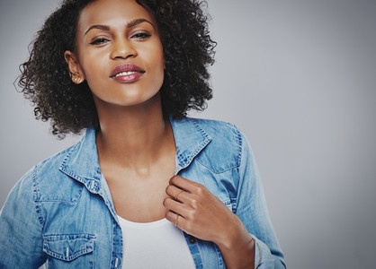 Gorgeous black woman in a blue denim jacket